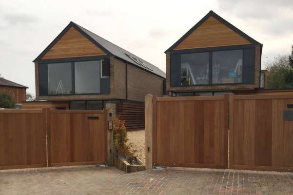 2 pairs of solid hardwood swing gates with intercoms and access control