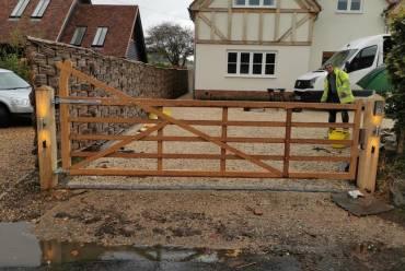 Wooden 5-bar gate installation