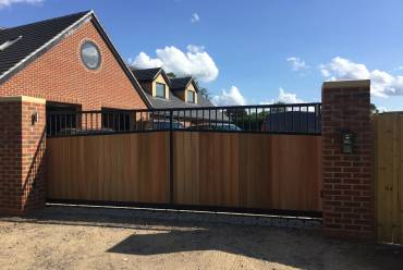 Sliding steel and timber electric gates