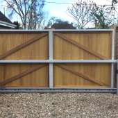 Sliding wooden clad metal framed gate