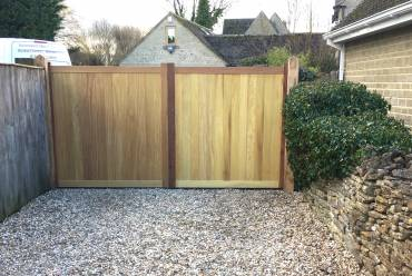 Sliding wooden clad metal framed gate
