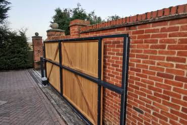 Sliding steel and timber gate