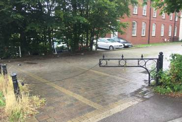 Old metal gate to be replaced with lifting barrier